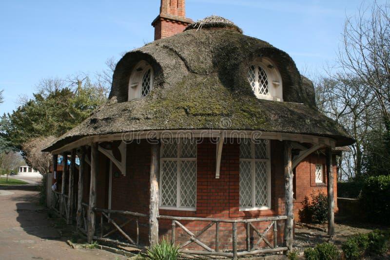Cottage del tetto del Thatch fotografie stock libere da diritti