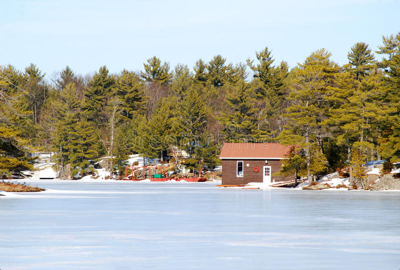 Cottage On A Frozen River Stock Photo