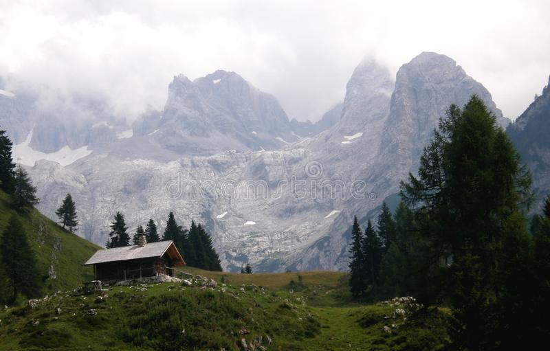Cottage high in the mountains. A small cottage high in the mountains among the peaks stock photo