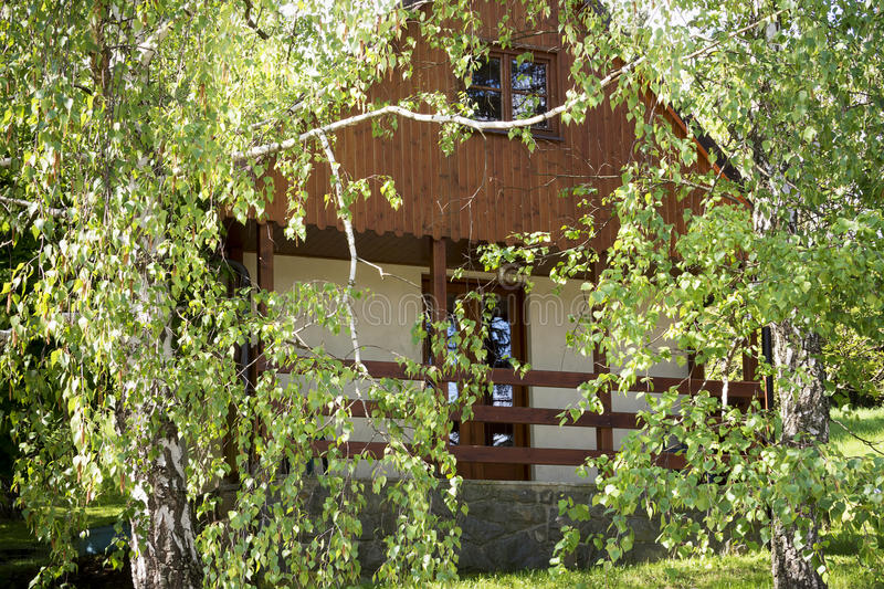 Cottage or holiday house. Cottage or holiday cabin house amoungst birch trees stock photography