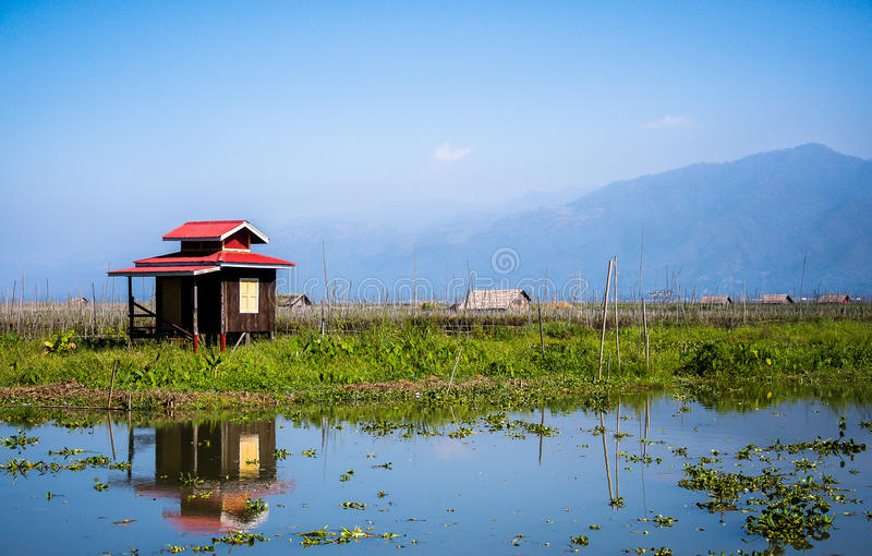 A cottage by Inle lake. Small cottage by Inle lake where villagers stay while taking care of their floating market, Shan state, Myanmar royalty free stock photography