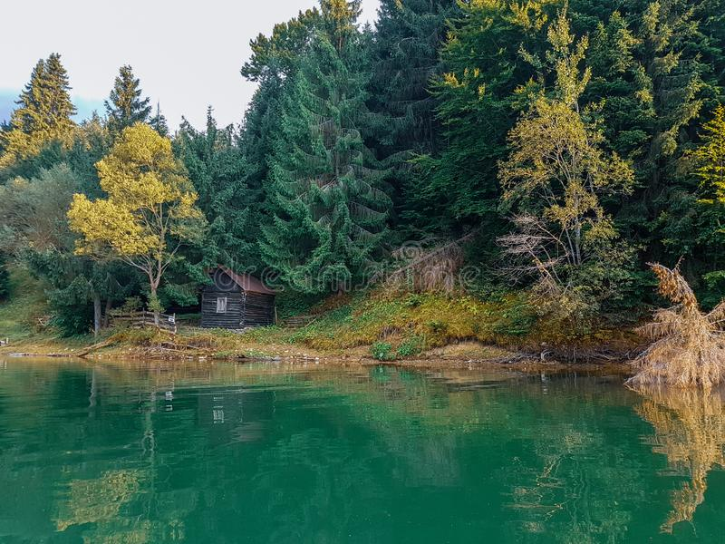 Cottage at the lake stock photography