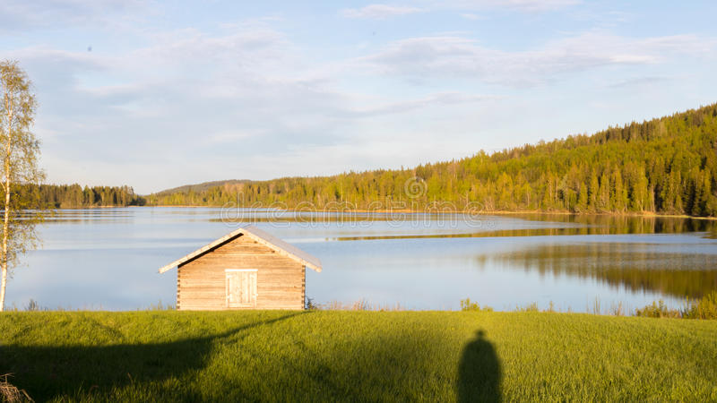 Cottage, lake and forest. stock photography