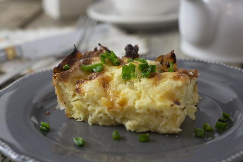 Cottage layered pie. Dough with cheese. Homemade pastry stock photo