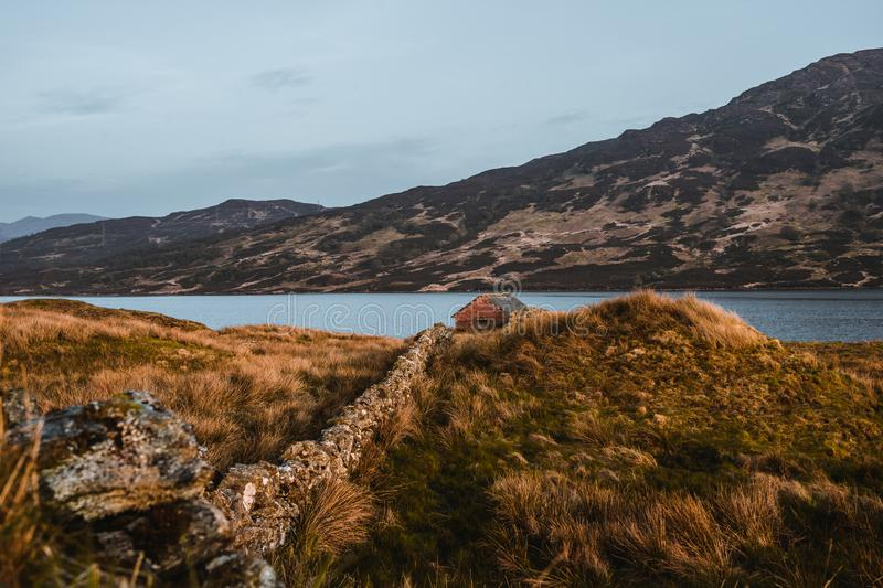 Cottage at loch arklet in Scotland royalty free stock photography