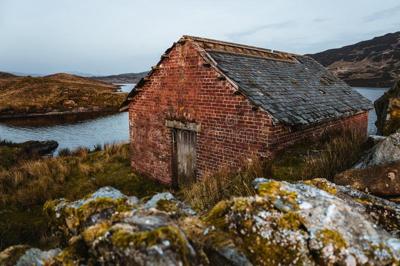 Cottage at loch arklet in Scotland stock photography