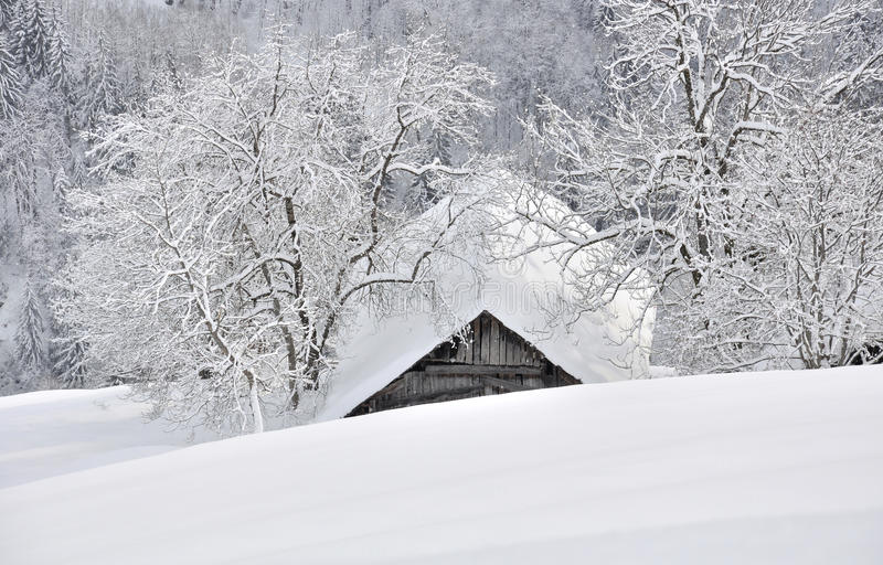Download Cottage Nestled In The Snowy Mountain Stock Image - Image: 22590321