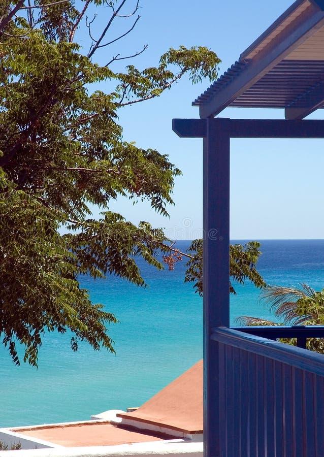 Cottage Overlooking Blue Ocean Stock Photo