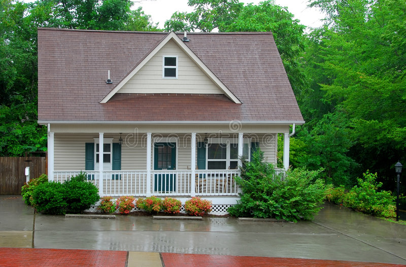 Download Cottage In The Rain Royalty Free Stock Image - Image: 1062876