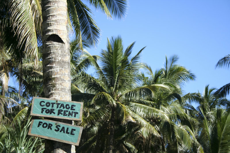 Cottage for rent sign palm trees stock images