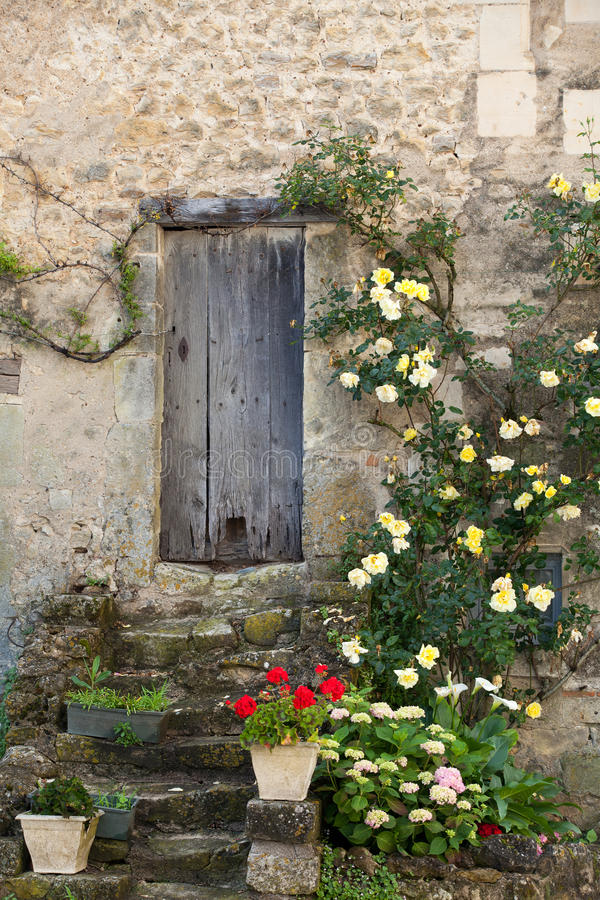 Cottage with roses royalty free stock images