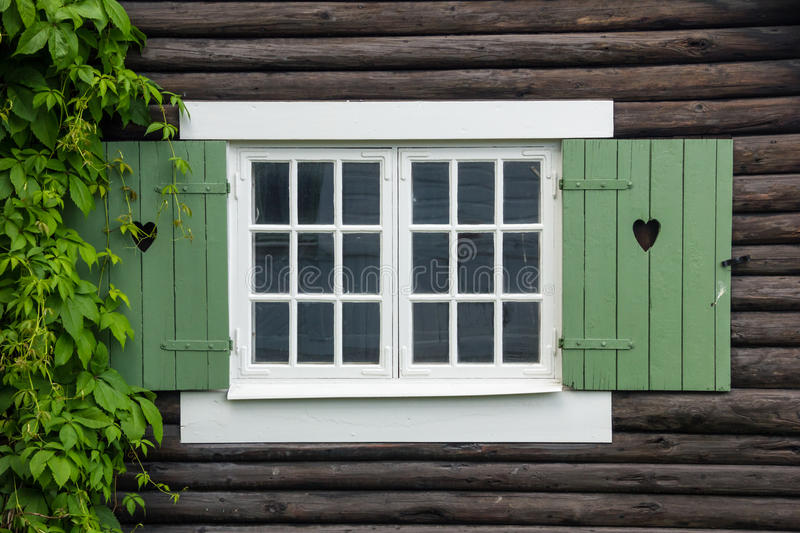 Cottage window shutters decorated with hearts. Sweden. Cottage wooden window shutters decorated with hearts. Linkoping. Sweden royalty free stock images