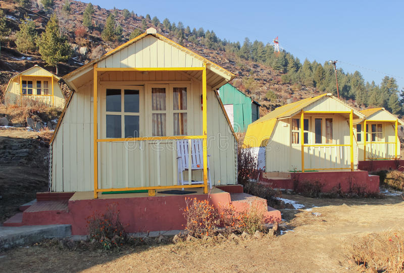Cottages at ski destination Auli Uttrakhand India. Cottages at picturesque hill station Auli of Uttrakhand. Tranquility and panoramic view of Himalayan ranges stock photo