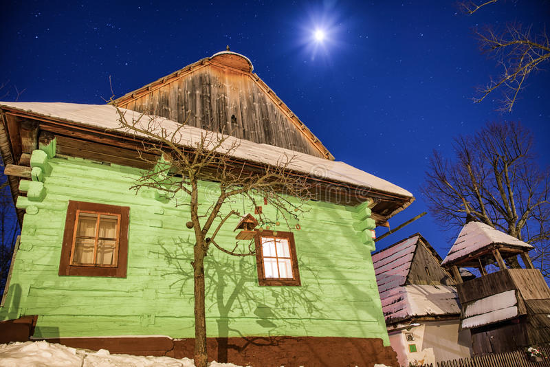 Cottages at winter night. Colorful wooden cottages in UNESCO rural village Vlkolinec at winter night, Slovakia royalty free stock image