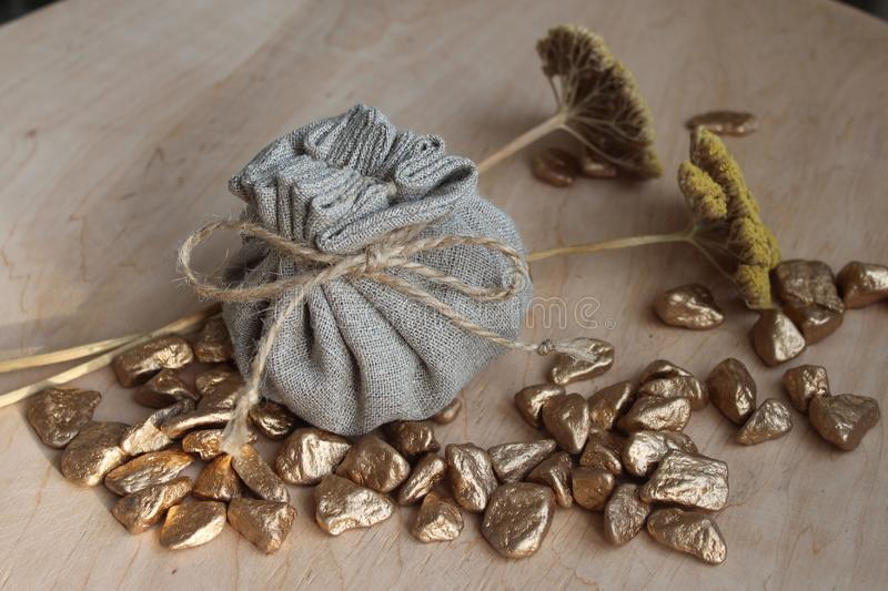 Cotton bag full of gold. Symbolizing richness and prosperity royalty free stock photo