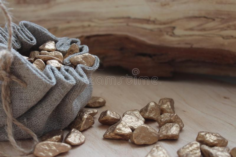 Cotton bag full of gold. Symbolizing richness and prosperity royalty free stock photography