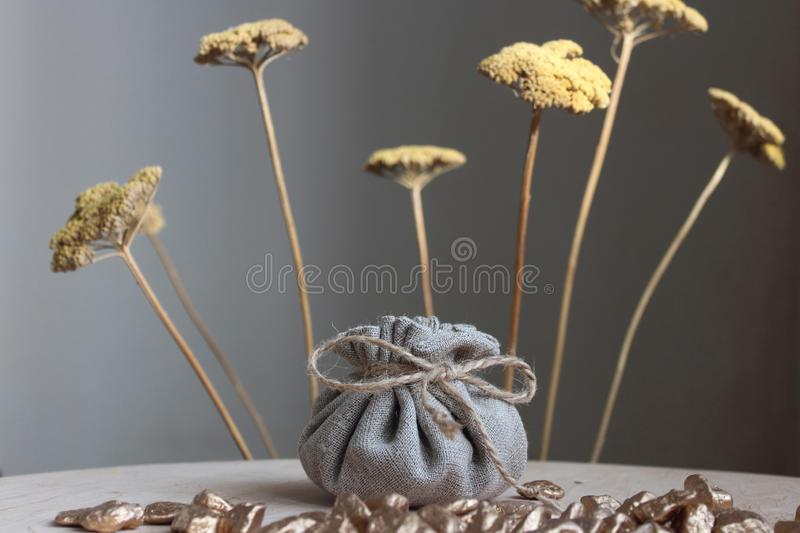 Cotton bag full of gold. Symbolizing richness and prosperity royalty free stock images