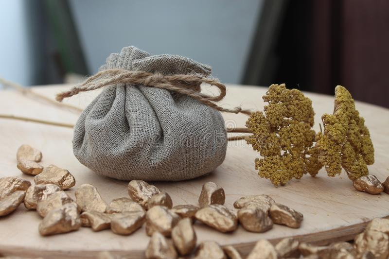 Cotton bag full of gold. Symbolizing richness and prosperity stock photos