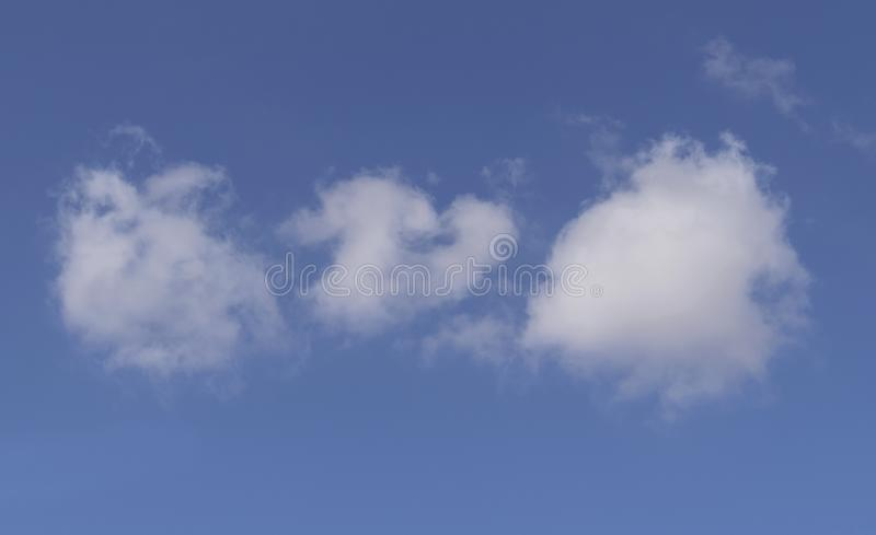 Cotton Ball Clouds in a Dazzling Blue Desert Sky royalty free stock photo