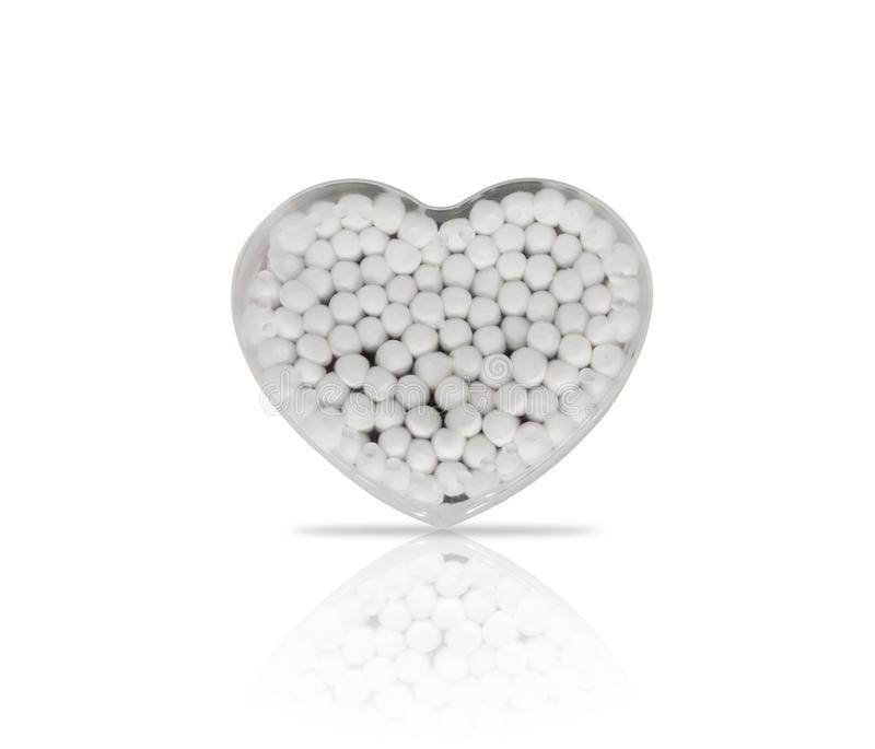 Cotton buds in a heart shape plastic container stock image
