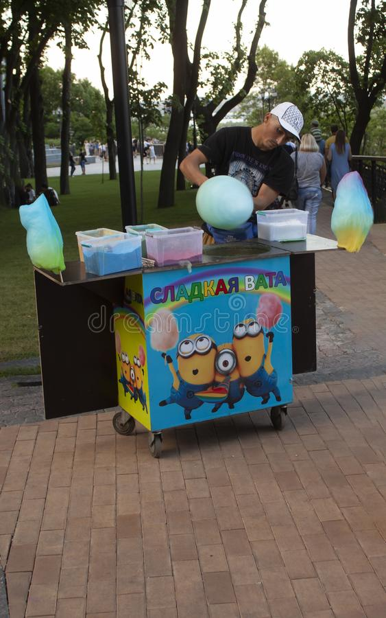 Cotton Candy Seller At Park making cotton candy. KIEV, UKRAINE 6/6/2019 Cotton Candy Seller At Park royalty free stock photo