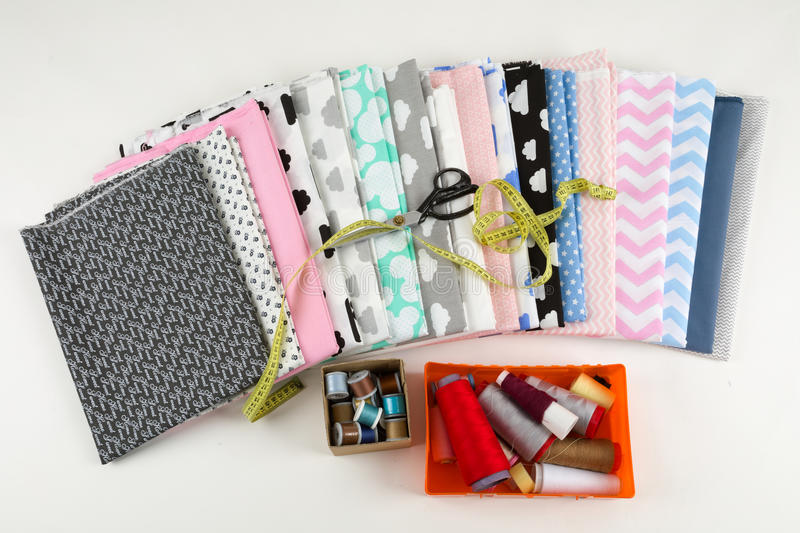 Cotton fabric material, tailor measurement tape and scissors royalty free stock photos