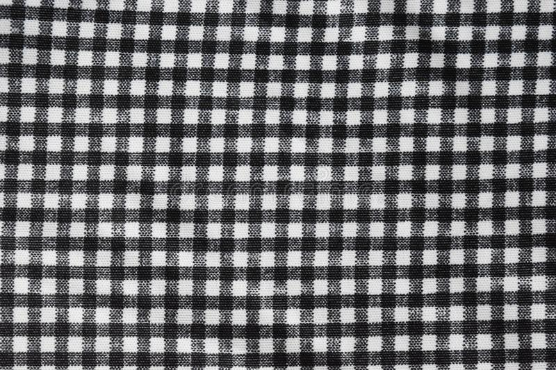 Cotton fabric natural ,Grid pattern black and white and Rough surface background. stock photography