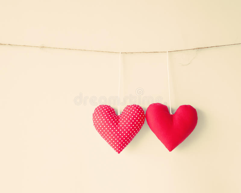 Cotton Hearts. Vintage cotton hearts hanging from a line royalty free stock photos