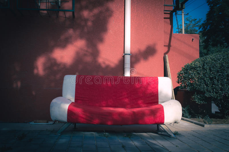Cotton sofa. Placed outside stock image