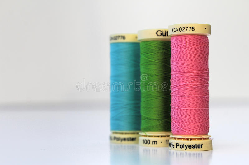 Cotton thread spool/reel three in a row royalty free stock image