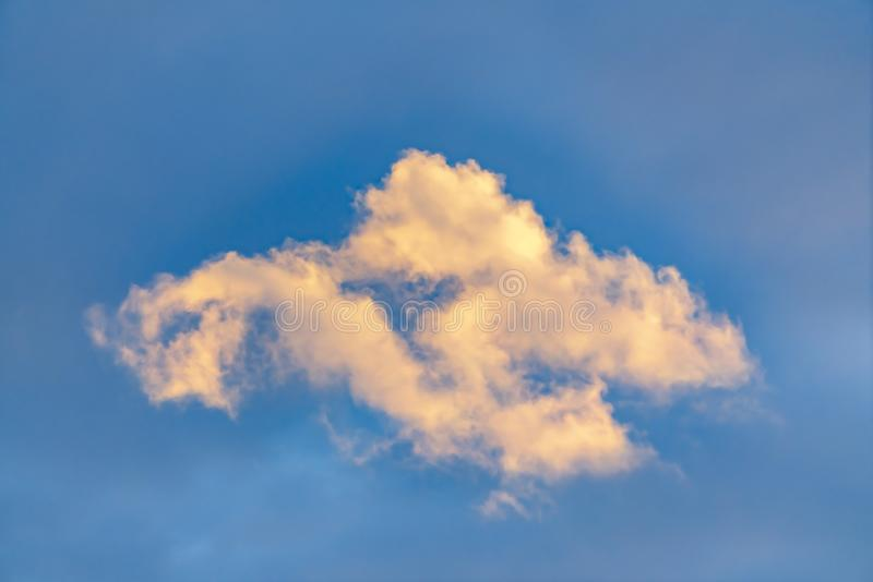 Cottony white clouds isolated against a vivid blue sky background royalty free stock photography