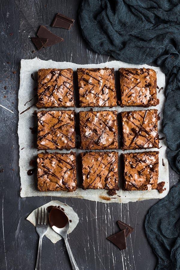Cottura dolce delle pasticcerie casalinghe della torta del pezzo del dolce del brownie del cioccolato immagini stock