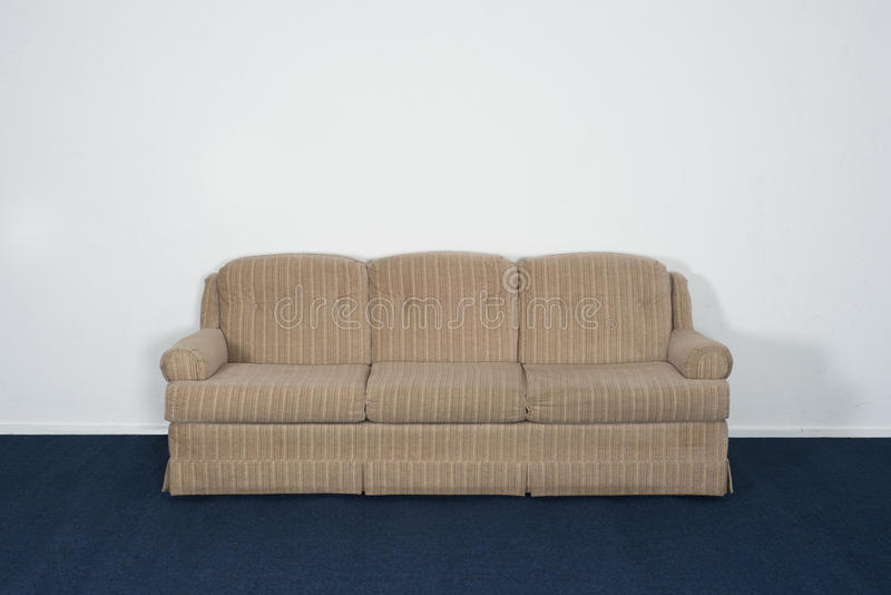 Couch or Davenport, Blue Carpet, Blank White Wall royalty free stock images
