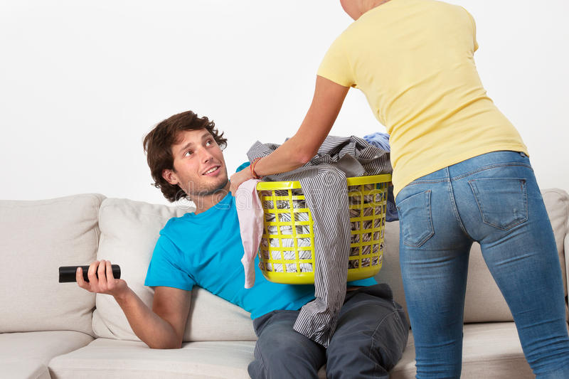 Couch potato and his wife royalty free stock image