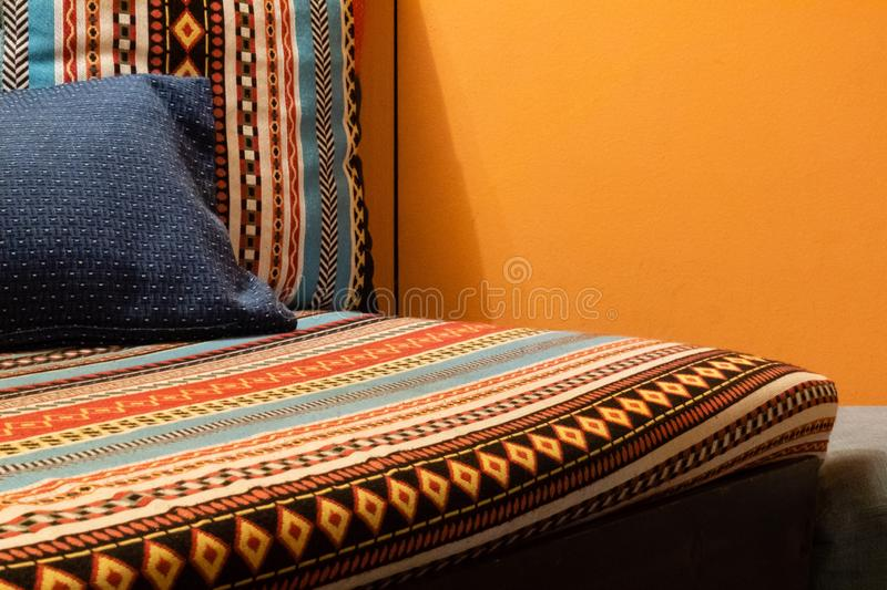 Couch with traditional pattern royalty free stock photo