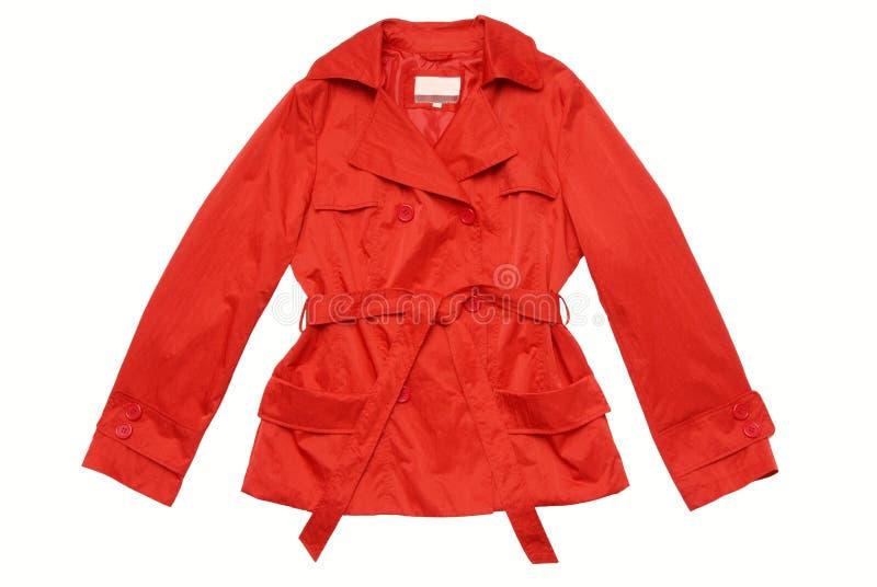 Couche/jupe/imperméable rouges, d'isolement. photos stock