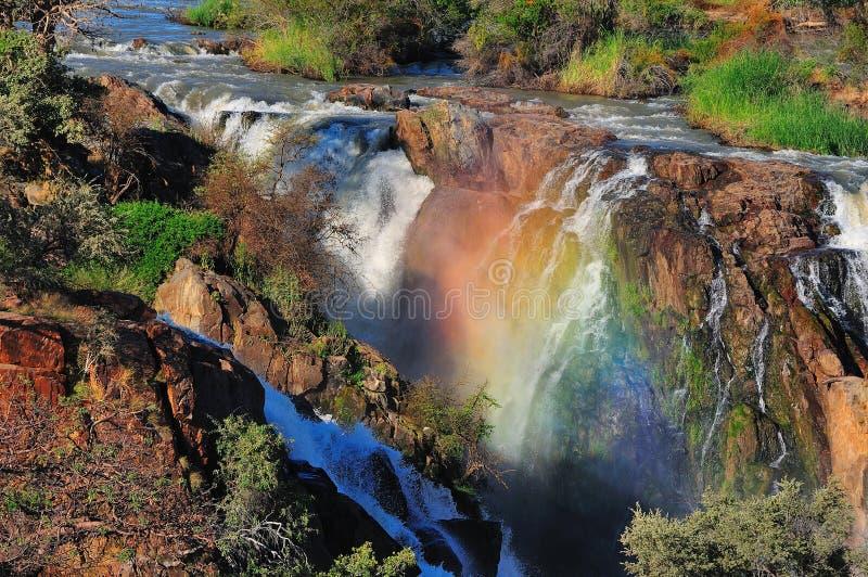 Coucher du soleil à la cascade à écriture ligne par ligne d'Epupa, Namibie image libre de droits