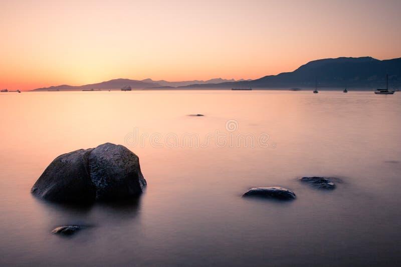 Coucher du soleil à la plage de Kitsilano image libre de droits