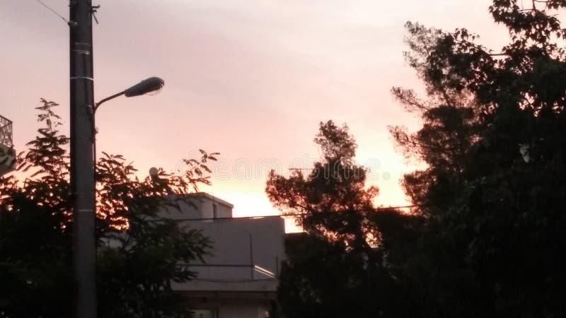 Coucher du soleil dans une soirée à Athènes image libre de droits