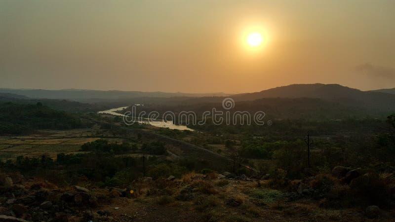 Coucher du soleil de ghat image libre de droits