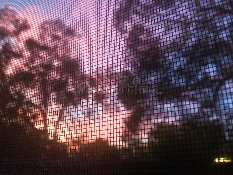 Coucher du soleil de grille photo stock