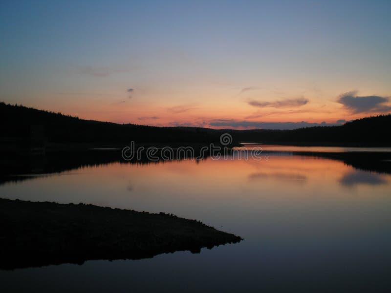 Coucher du soleil de lac image libre de droits