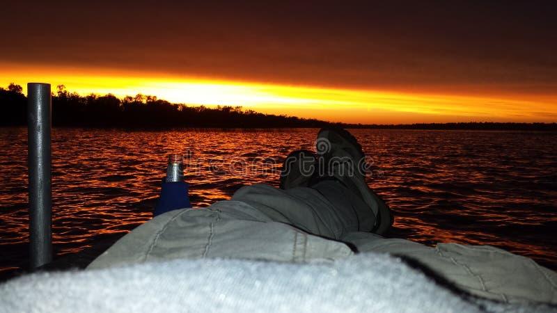 Coucher du soleil de lac minnesota avec moi et le dock image stock