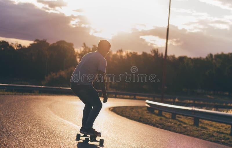 Coucher du soleil de Longboard photos libres de droits