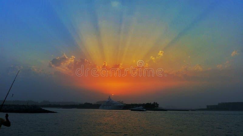 Coucher du soleil de pêche photographie stock
