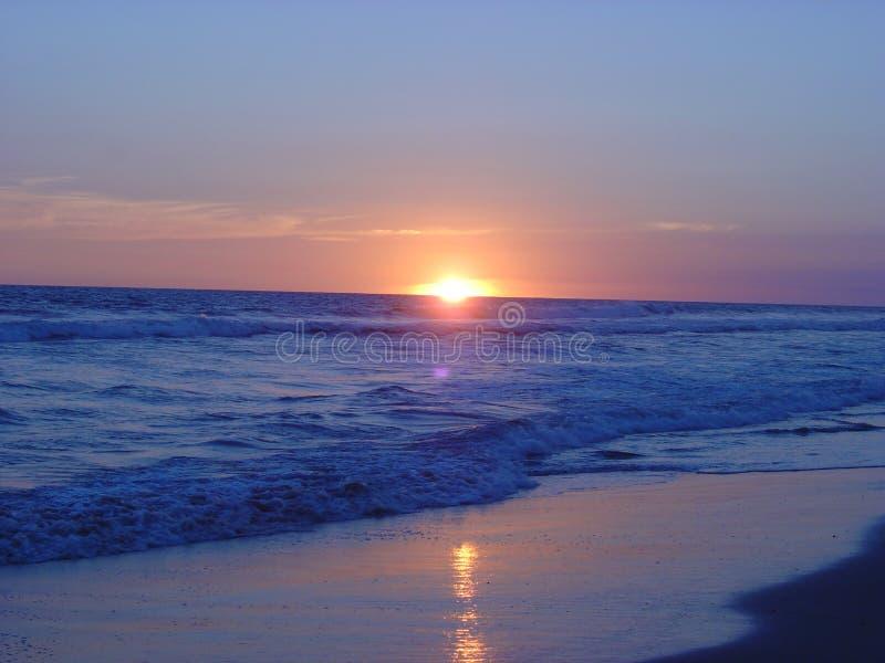 Coucher du soleil de plage images stock