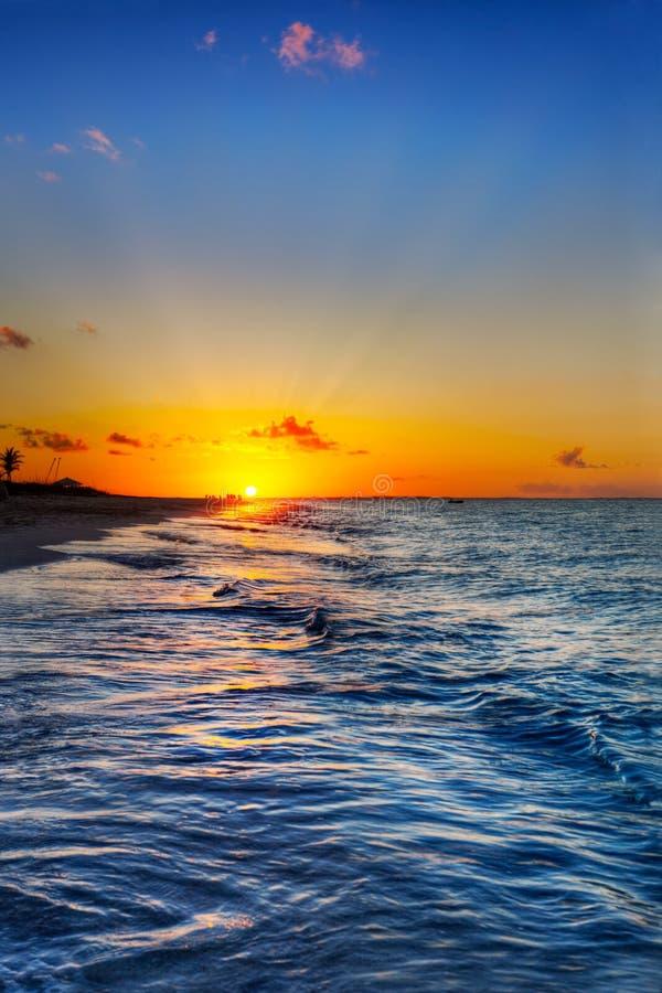 Coucher du soleil de plage de compartiment de grace images stock