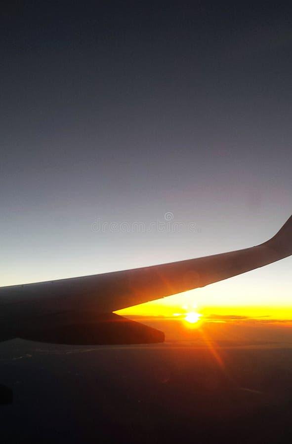 Coucher du soleil de vol image libre de droits