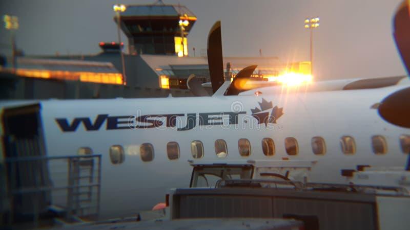 Coucher du soleil de WestJet image stock