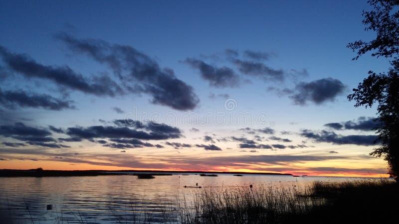 Coucher du soleil en Finlande images libres de droits